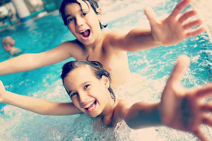 Family-Travel-Saving-Money-Kids-in-Pool