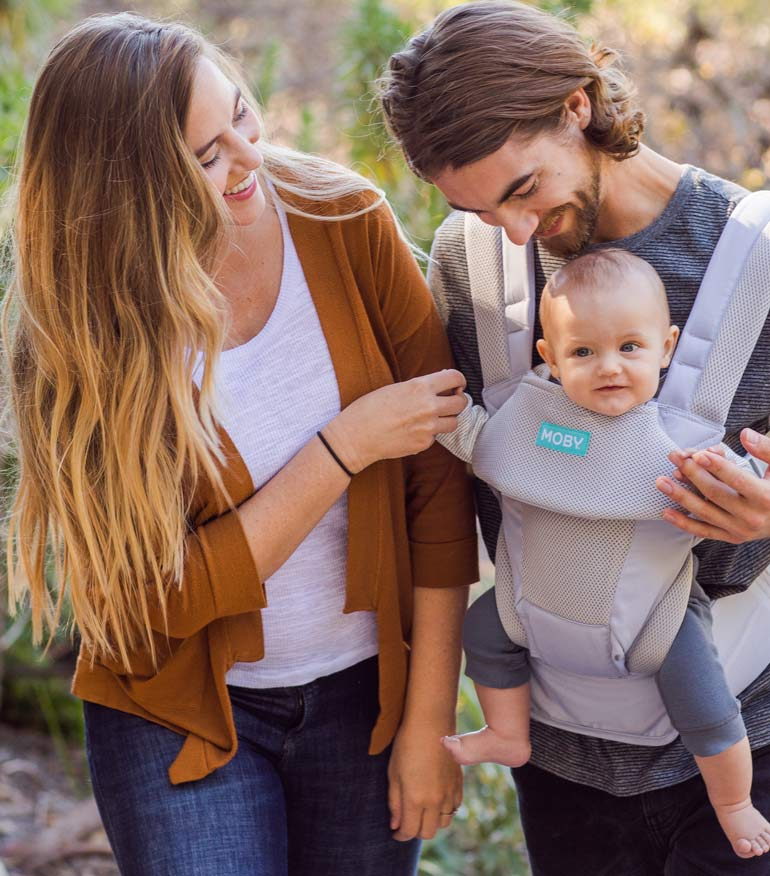 baby in Moby Move baby carrier with parents