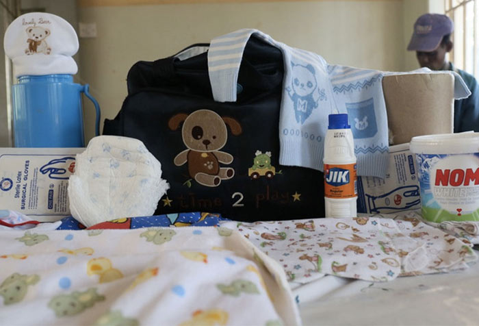 Kemisa's hospital bag included baby's clothes, surgical gloves, washing powder, disinfectant, a flask and cup, a wrap, nappies and bedding. Photo: WaterAid UK