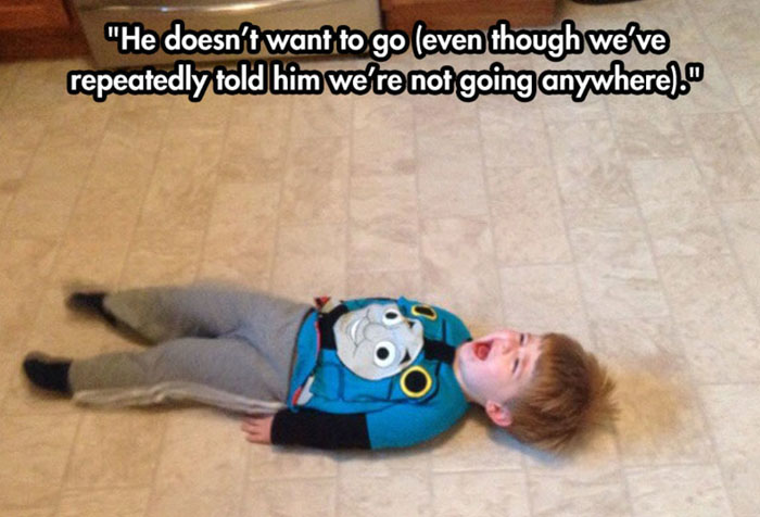 Crying child while lying on the floor