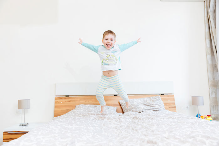 boy-jumping-on-bed