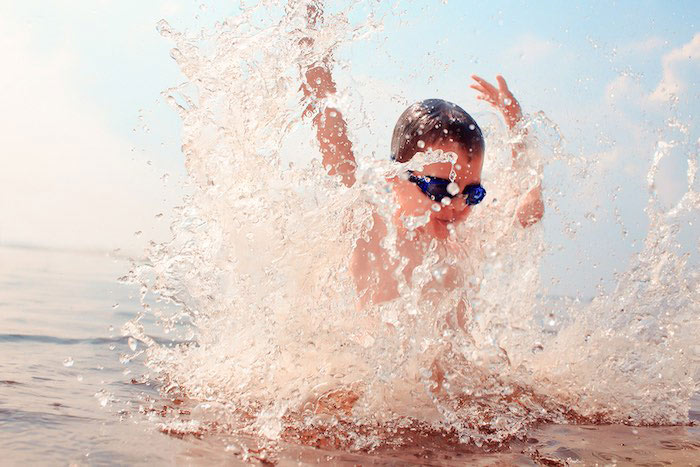 boy-splashing-in-water