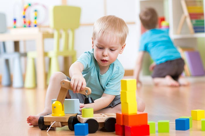 toddler-concentrating-on-toys