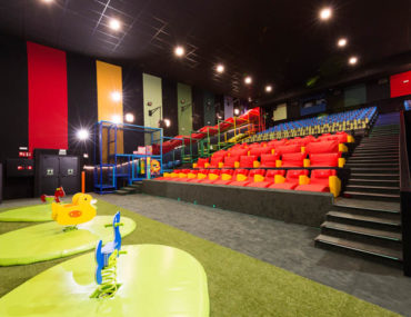 Cinepolis Junior Cinema front playground space and brightly colored cinema chairs