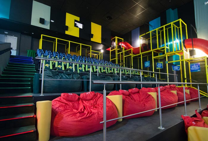 Cinepolis Junior Cinema section with the brightly colored beanbags and slides playground at the far end