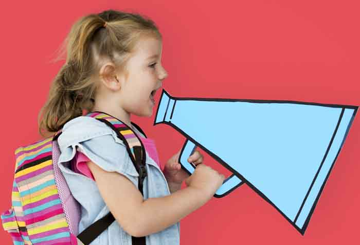 little girl with colorful backpack holding a retro megaphone in red background