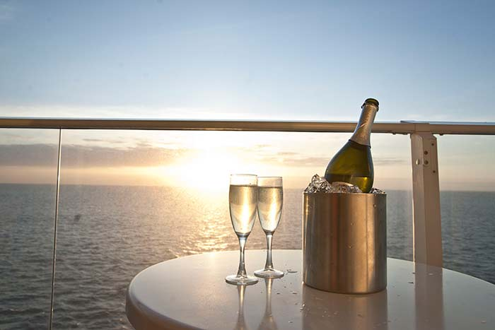 family-cruising-champagne-sunset