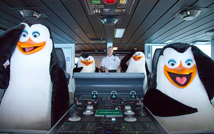 family-cruising-penguins-captain