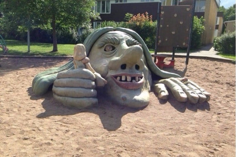 troll statue in playground