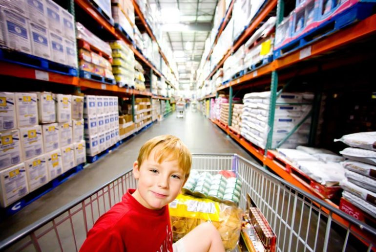 kid in trolley at Costco as Costco reveals plans to launch online store in Australia