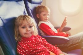 Mum furious after Qantas sits her kids with strangers