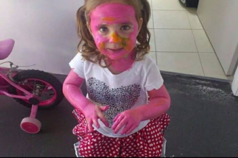 young child covered in paint
