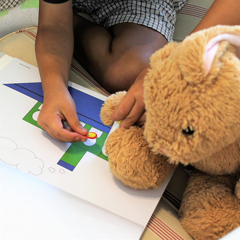 child playing with shapeeze activity kits
