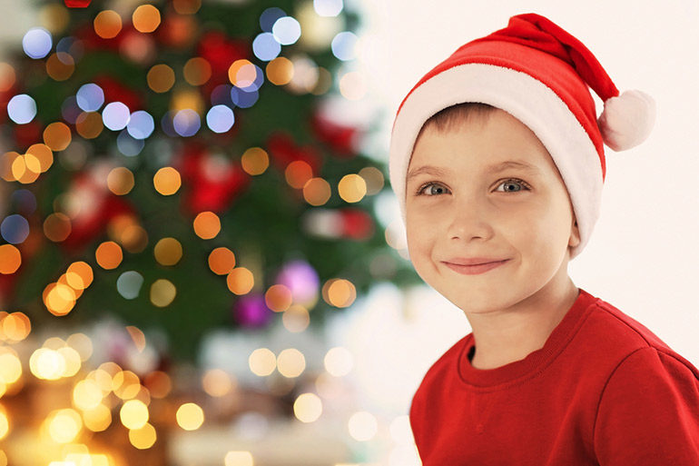 boy wearing santa hat questions about Santa