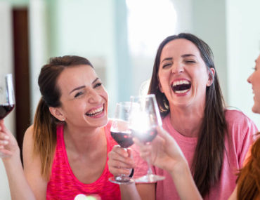 women laughing with wine | things for mum