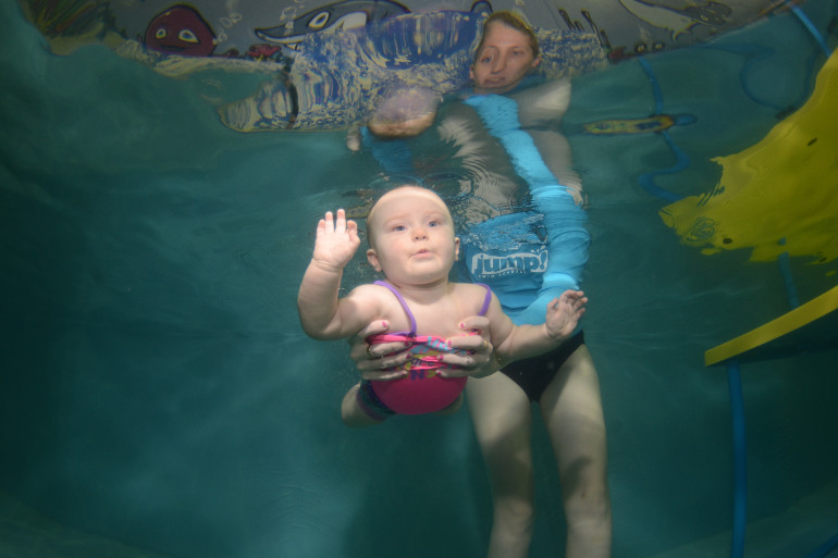 Baby learning to swim under water
