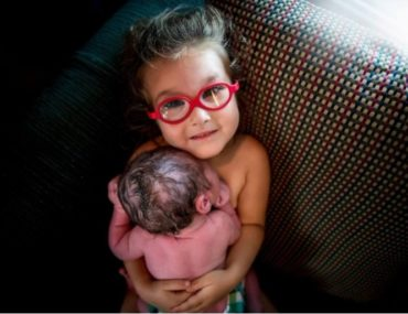 three year old helps deliver baby brother