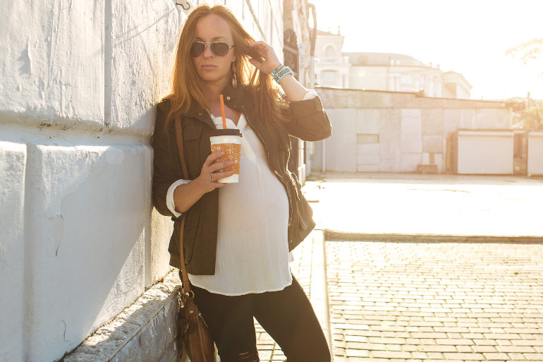 pregnant woman with coffee cup