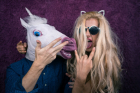 woman with man in unicorn mask