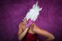 woman wearing unicorn head | unicorn mums