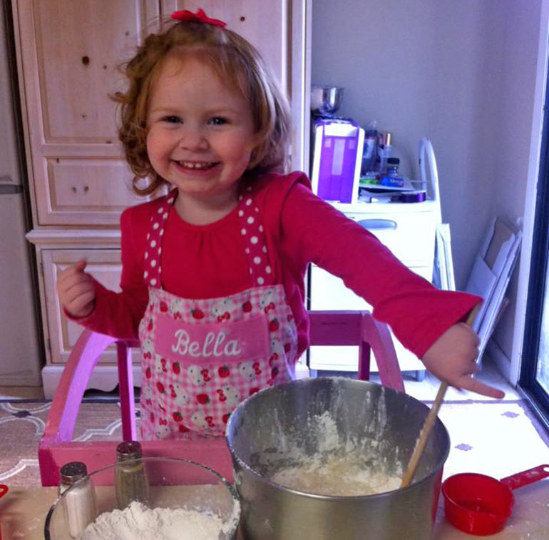 little girl makes cake for mum in heaven
