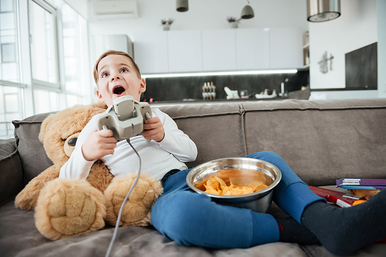 things I swore my kids would never do - play video games and eat on the couch