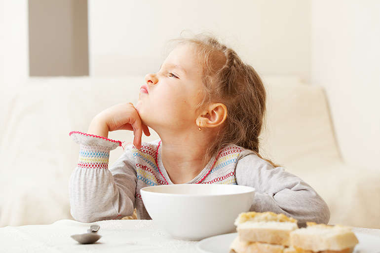 child eating breakfast cereal