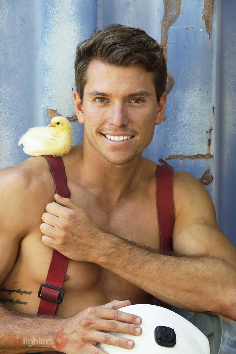Baby chick and Australian firefighter