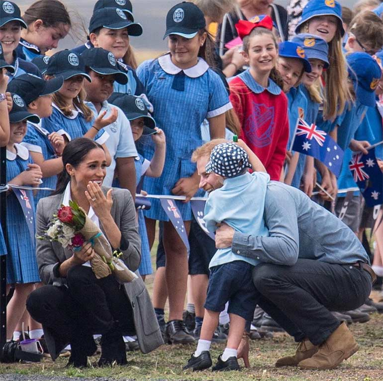 schoolboy Luke hugs Prince Harry in Dubbo