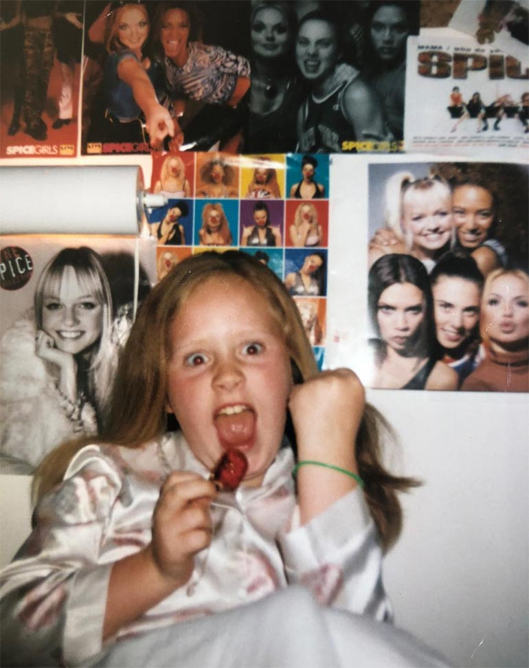 Adele as a child with Spice Girl posters
