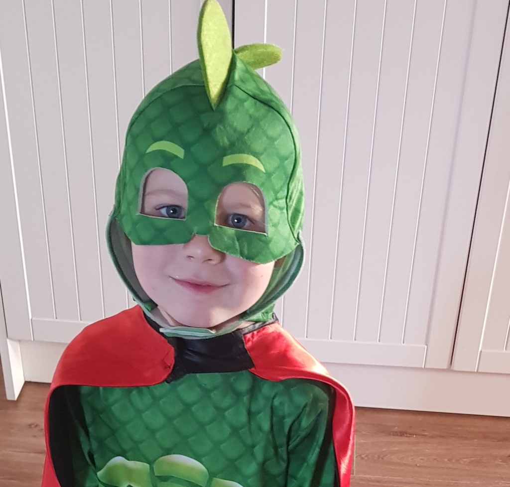 Boy in PJ Masks gecko costume