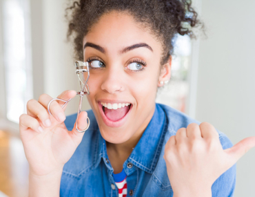 beauty hacks, woman with eyelash curler