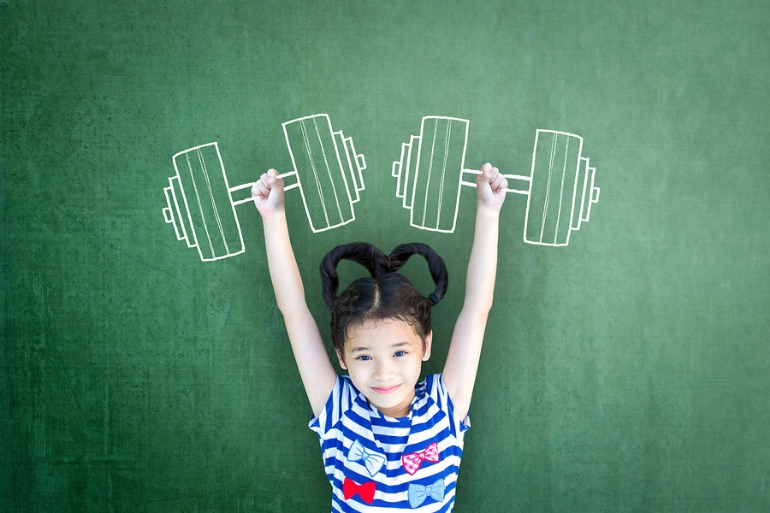 Girl holding imaginary weights above her head