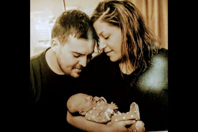 Parents Jessica Bramer and christian reed with baby skylah