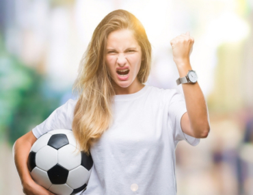 Woman-holding-football-with fist-up-angry