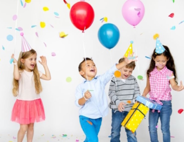young kids holding balloons and presents, kids party
