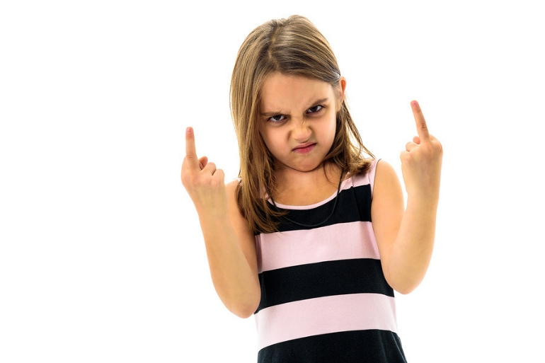 young girl holding up middle finger, mum guilt