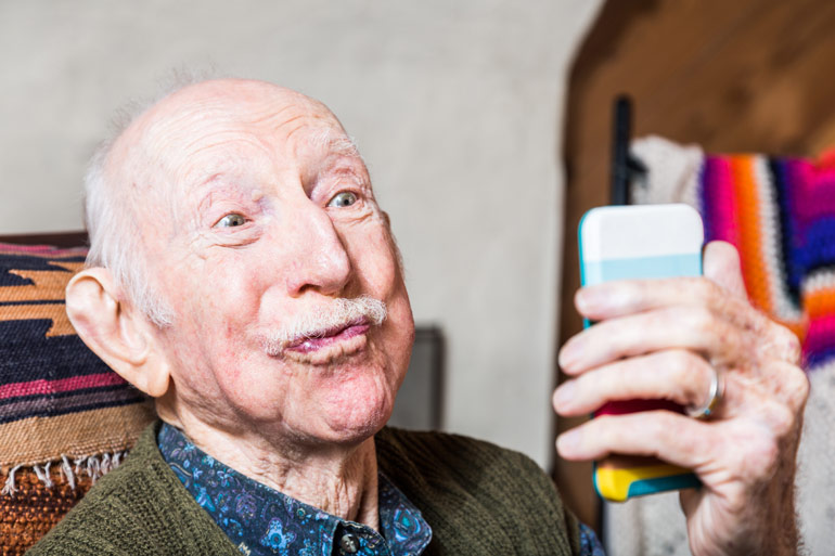 Granddad with smartphone, rules for grandparents