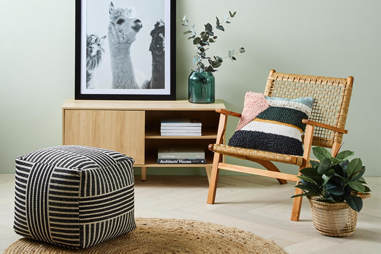 console, furniture, chair, ottoman, rug, plant, wall art, vase