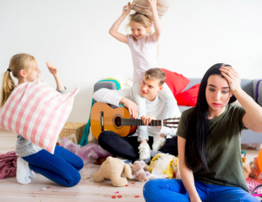 Stressed mum at home with kids