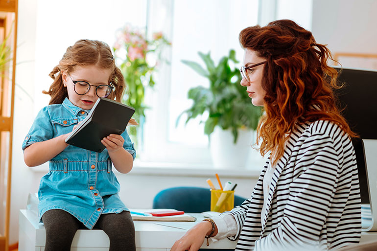 mother and daughter in office wearing glasses