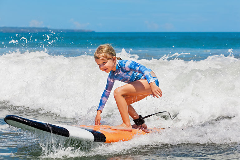 child surfing school holiday actvities