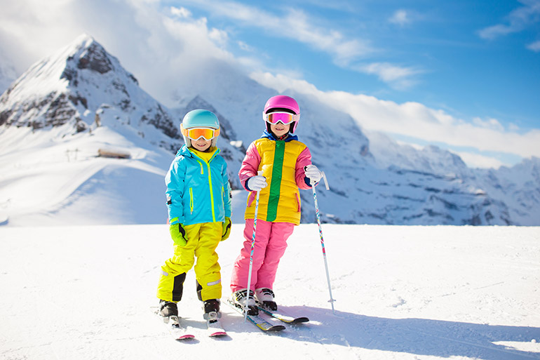 children skiing school holiday activities