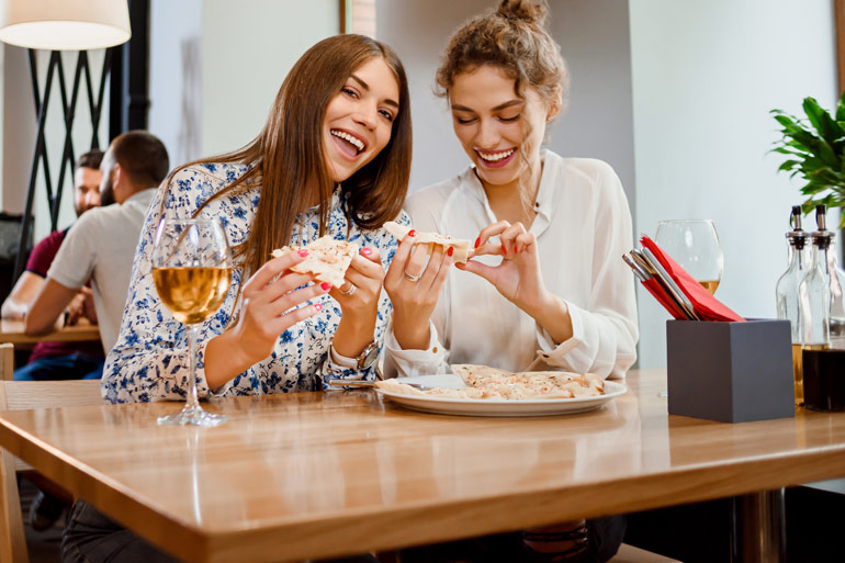 Things for mum | two ladies having a meal with wine, group payment app Payk