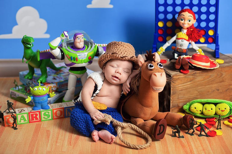 newborn dressed as Toy story 4 Woody