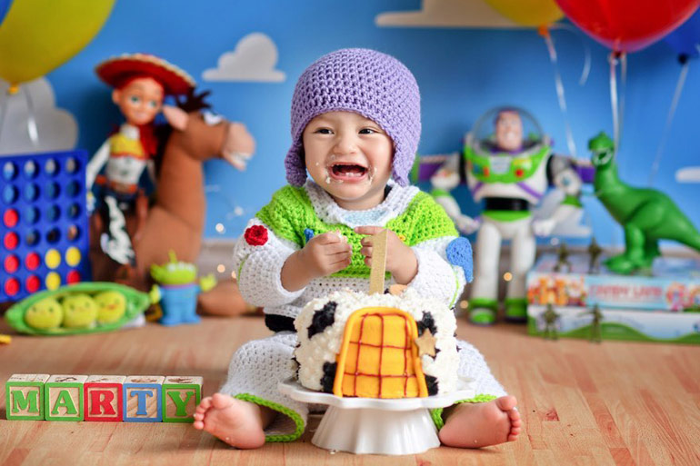Newborn dressed as Toy Story 4 Buzz Lightyear