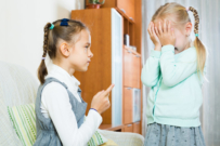 girl pointing finger at her sister | blaming