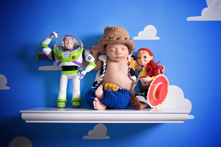 newborn dressed as woody from Toy Story - newborn portrait