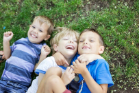 three happy young boys, siblings