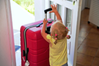 Toddler with suitcase at airport